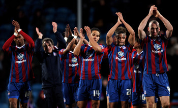 Crystal Palace players salute their fans