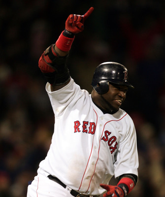 Ortiz celebrates his walk off single to win game 5 of the 2004 ALCS.