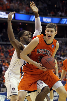 WASHINGTON - MARCH 17:  Mike Muscala #31 of the Bucknell Bison tries to get past Roscoe Smith #22 of the Connecticut Huskies during the second round of the 2011 NCAA men's basketball tournament at the Verizon Center on March 17, 2011 in Washington, DC.  (