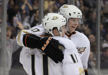 Saku Koivu and Corey Perry celebrate a goal.