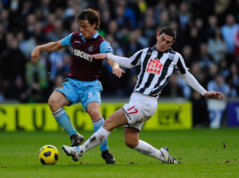 Parker in action for West Ham United against West Bromwich Albion last season, a game in which he is credited for inspring their comeback from three goals down to draw 3-3.