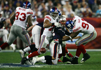 Tuck forces Brady to fumble in Super Bowl XLII.