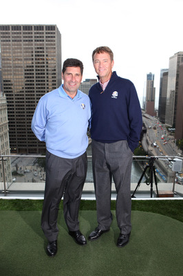 CHICAGO, IL - SEPTEMBER 26: European Ryder Cup Captain Jose Maria Olazabal (L) and U.S. Ryder Cup Captain Davis Love III (R) teed-off for a once-in-a lifetime golf shot from Trump International Hotel & Tower Chicago's 16th Floor Terrace on September 26, 2