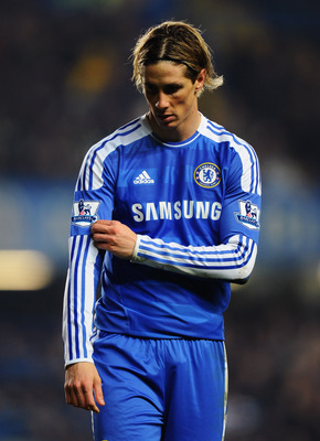 LONDON, ENGLAND - FEBRUARY 05:  Fernando Torres of Chelsea looks thoughtful during the Barclays Premier League match between Chelsea and Manchester United at Stamford Bridge on February 5, 2012 in London, England.  (Photo by Mike Hewitt/Getty Images)