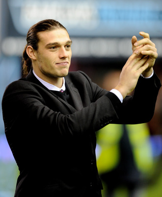 Carroll applauds the Liverpool fans on his first appearance at Anfield