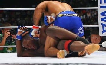 Jason High (bottom) fending off Andre Galvao; photo cred: sherdog.com