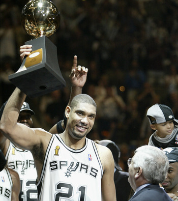 Tim Duncan hoists the 2003 NBA Finals Trophy.