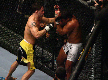 Frankie Edgar (left) with Tyson Griffin/ photo cred: MMAWeekly.com