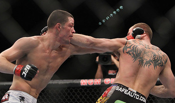 Nate Diaz (left) lunging at Donald Cerrone/ photo cred: Scott Petersen for MMAWeekly.com