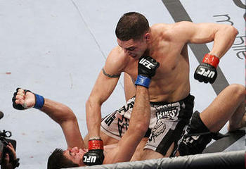 Diego Sanchez (top) pounding away on Paulo Thiago/ photo cred: Scott Petersen for MMAWeekly.com