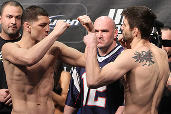 Nick Diaz (left) squaring off with Carlos Condit/ photo cred: Scott Petersen for MMAWeekly.com