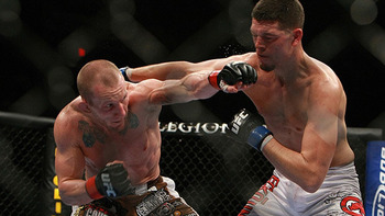 Gray Maynard (left) lunging at Nate Diaz/ photo cred: Dave Mandel at Sherdog.com
