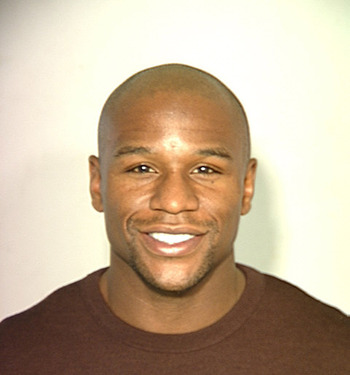 Floyd Mayweather smiling during a mugshot