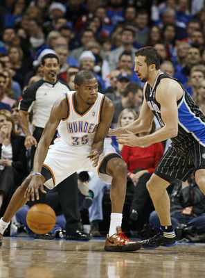 OKLAHOMA CITY, OK -DECEMBER 25:  Kevin Durant #35 of the Oklahoma City Thunder looks to drive on Hedo Turkoglu #15 of the Orlando Magic during the NBA season opening game December 25, 2011 at the Chesapeake Energy Arena in Oklahoma City, Oklahoma.  Oklaho
