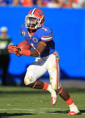 JACKSONVILLE, FL - JANUARY 02:  Chris Rainey #1 of the Florida Gators runs upfield against the Ohio State Buckeyes during the TaxSlayer.com Gator Bowl at EverBank Field on January 2, 2012 in Jacksonville, Florida.  (Photo by Scott Halleran/Getty Images)