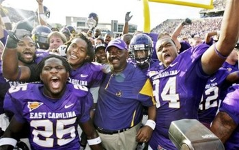 East-carolina-coach-ruffin-mcneill-and-his-players-celebrate-their-win-over-tulsa-credit-associated-press_display_image