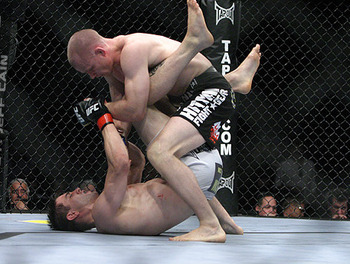 Kampmann (top) pounding away on Carlos Condit/ Jeff Cain for MMAWeekly.com