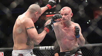 Kampmann (right) against Sanchez/ Ken Pishna for MMAWeekly.com