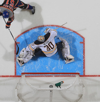 UNIONDALE, NY - FEBRUARY 04:  Ryan Miller #30 of the Buffalo Sabres stops Frans Nielsen #51 of the New York Islanders in the shootout at the Nassau Veterans Memorial Coliseum on February 4, 2012 in Uniondale, New York. The Sabres defeated the Islanders 4-