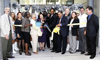 Oakland Mayor Jean Quan, Oakland City Council President Larry Reid, Oakland Parks and Recreation Director Audree Jones-Taylor, Raiders Hall of Famer Jim Otto and the Raiderettes cut the ribbon at the East Oakland Sports Complex. Photo by Tony Gonzales.