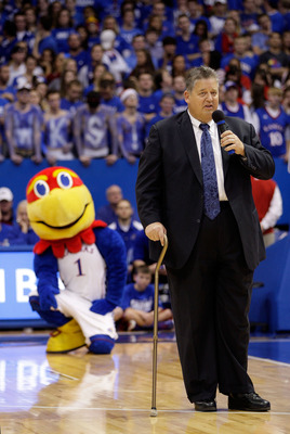 LAWRENCE, KS - DECEMBER 10:  New head football coach Charlie Weis of the Kansas Jayhawks adresses the arena during halftime of the game between the Jayhawks and the Ohio State Buckeyes on December 10, 2011 at Allen Fieldhouse in Lawrence, Kansas.  (Photo