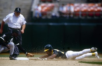 OAKLAND, CA - JUNE 13:  Rickey Henderson #24 of the Oakland Athletics steals second base during their MLB game against the Chicago White Sox on June 13, 1995 at Oakland-Alameda County Coliseum in Oakland, California. (Photo by Otto Greule Jr./Getty Images