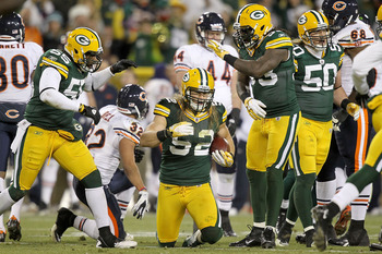GREEN BAY, WI - DECEMBER 25: Clay Matthews #52 of the Green Bay Packers recovers an interception against the Chicago Bears at Lambeau Field on December 25, 2011 in Green Bay, Wisconsin.  (Photo by Matthew Stockman/Getty Images)