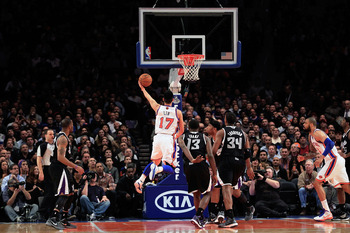 NEW YORK, NY - FEBRUARY 15:  Jeremy Lin #17 of the New York Knicks shoots against the Sacramento Kings at Madison Square Garden on February 15, 2012 in New York City. NOTE TO USER: User expressly acknowledges and agrees that, by downloading and/or using t