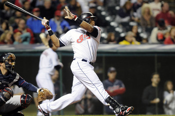 CLEVELAND, OH - SEPTEMBER 23: Carlos Santana #41 of the Cleveland Indians hits a solo, walk-off home run to defeat the Minnesota Twins 6-5 at Progressive Field on September 23, 2011 in Cleveland, Ohio. The Indians defeated the Twins 6-5. (Photo by Jason M