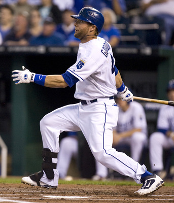 KANSAS CITY, MO - SEPTEMBER 20:  Alex Gordon #4 of the Kansas City Royals hits a home run in the first inning during a game against the Detroit Tigers at Kauffman Stadium on September 20, 2011 in Kansas City, Missouri. (Photo by Ed Zurga/Getty Images)
