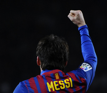 BARCELONA, SPAIN - FEBRUARY 19:  Lionel Messi of FC Barcelona celebrates after scoring his team's second goal during the La Liga match between FC Barcelona and Valencia CF at Camp Nou stadium on February 19, 2012 in Barcelona, Spain. FC Barcelons won 5-1.