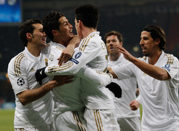 MOSCOW, RUSSIA - FEBRUARY 21:  Cristiano Ronaldo of Real Madrid celebrates with teammates after scoring the opening goal during the UEFA Champions League round of 16, first leg match between CSKA Moscow and Real Madrid at the Luzhniki Stadium on February