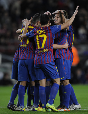 BARCELONA, SPAIN - DECEMBER 06:  FC Barcelona players celebrate after Sergio Roberto of FC Barcelona scored the opening goal during the UEFA Champions League group H match between FC Barcelona and FC BATE Borisov at Camp Nou on December 6, 2011 in Barcelo