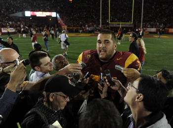 Matt Kalil (75) talking with reports after USC's victory over Utah.