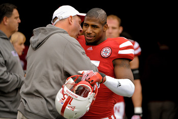 Alfonzo Dennard receiving a hug from head coach Bo Pelini.