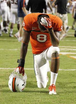 Tommy Streeter (8) saying his prayers before facing Virginia Tech.