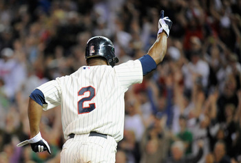 MINNEAPOLIS, MN - SEPTEMBER 28: Denard Span #2 of the Minnesota Twins celebrates as he runs home scoring the winning the walk-off run in the ninth inning against the Kansas City Royals on September 28, 2011 at Target Field in Minneapolis, Minnesota. The T