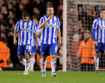 LIVERPOOL, ENGLAND - FEBRUARY 19:  Alan Navarro of Brighton & Hove Albion and his team mates show their dejection during the FA Cup Fifth Round match between Liverpool and Brighton & Hove Albion at Anfield on February 19, 2012 in Liverpool, England. (Phot