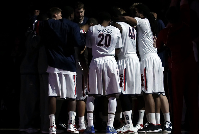 TUCSON, AZ - DECEMBER 10:  The Arizona Wildcats huddle up before the college basketball game against the Clemson Tigers at McKale Center on December 10, 2011 in Tucson, Arizona. The Wildcats defeated the Tigers 63-47.  (Photo by Christian Petersen/Getty I