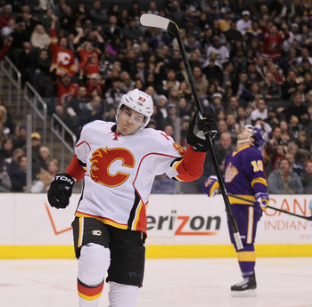 LOS ANGELES, CA - FEBRUARY 18:  Mike Cammalleri #93 of the Calgary Flames celebrates a goal against the Los Angeles Kings in the third period at Staples Center on February 18, 2012 in Los Angeles, California. The Flames defeated the Kings 1-0.  (Photo by