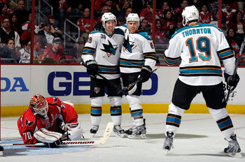 WASHINGTON, DC - FEBRUARY 13:  Joe Pavelski #8 of the San Jose Sharks celebrates with Logan Couture #39 and Joe Thornton #19 after scoring in the second period against the Washington Capitals at the Verizon Center on February 13, 2012 in Washington, DC.