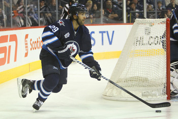 WINNIPEG, CANADA - FEBRUARY 19: Johnny Oduya #29 of the Winnipeg Jets skates out with the puck during their NHL game against the Colorado Avalanche at MTS Centre on February 19, 2012 in Winnipeg, Manitoba, Canada. (Photo by Tom Szczerbowski/Getty Images)