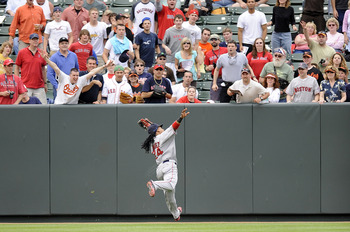 Manny making a catch just before high-fiving a Boston fan in Baltimore.