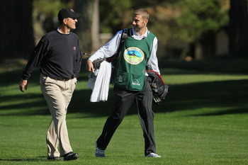 Alex Smith caddied for Jim Harbaugh at the AT&T golf tournament
