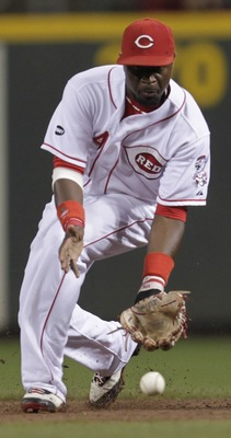 Brandon Phillips goes to field the grounder.