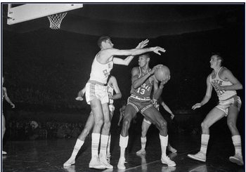 Lennie Rosenbluth sets up a block on Wilt Chamberlain.