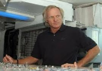 Greg Norman at the controls of his Yacht.