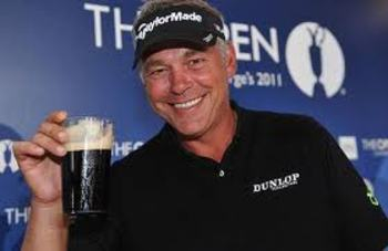 Darren Clarke enjoys a pint after his British Open win.