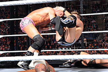 Chris Jericho delivers a Codebreaker to Dolph Ziggler.