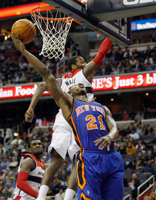 Iman Shumpert attempts a layup in New York's win over Washington.